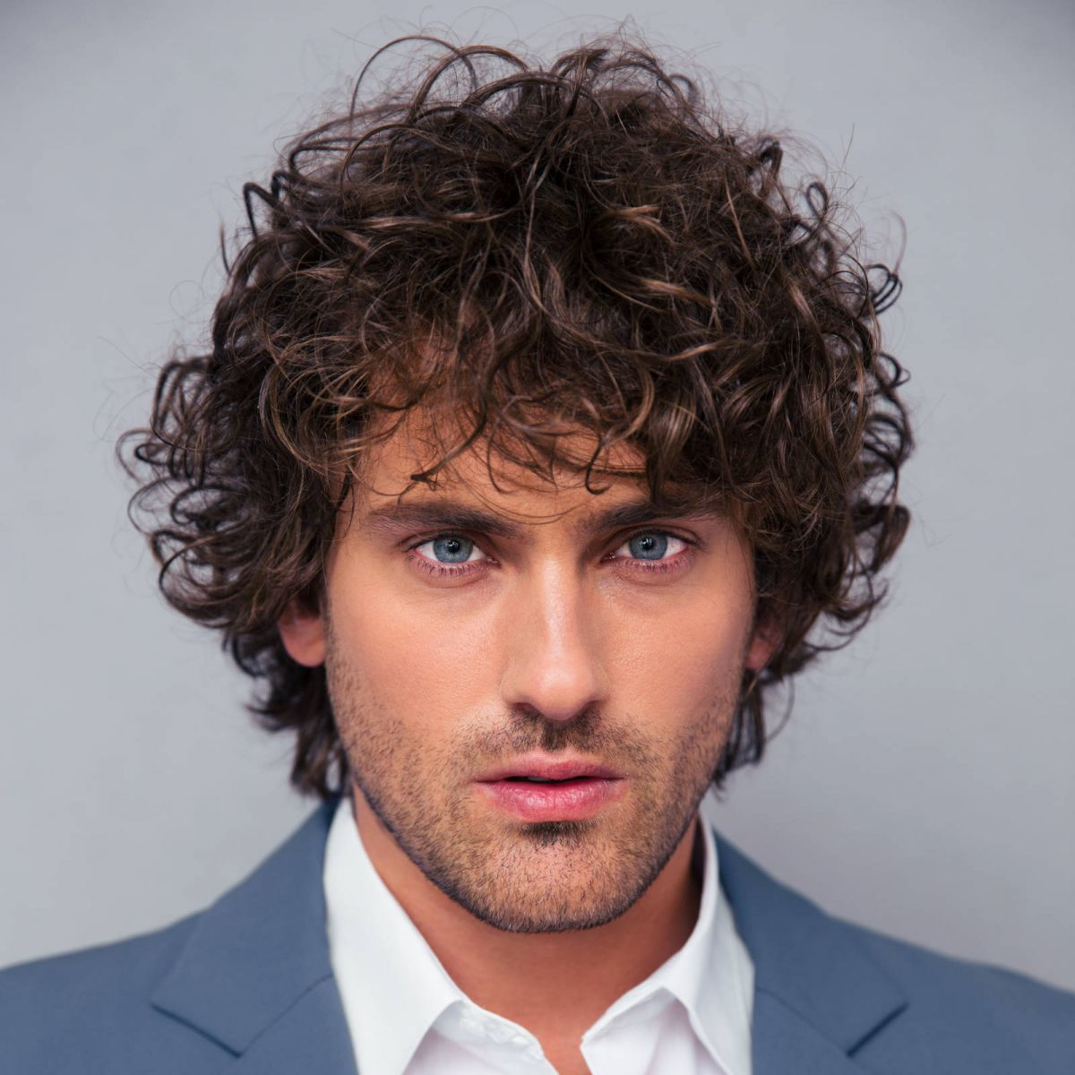 Top of hairstyles for curly hair men